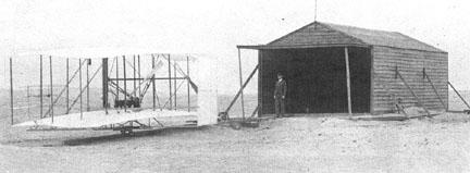 A wooden airplane hangar, not a steel airplane hangar